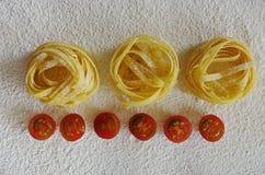 Raw ribbon pasta Stock Photos