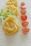 Raw ribbon pasta Stock Photo