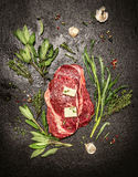 Raw ribey steaks with fresh aromatic herbs, butter and garlic Stock Images