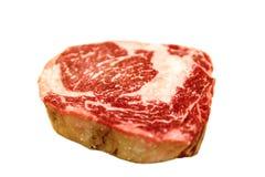 Raw ribeye beef lies on a white background. stock photo