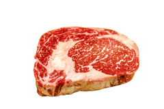 Raw ribeye beef lies on a white background. royalty free stock photo