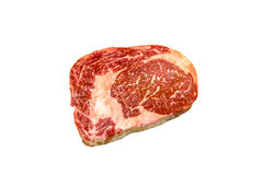 Raw ribeye beef lies on a white background. royalty free stock images
