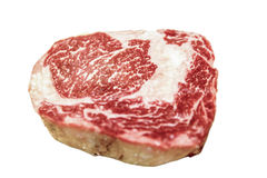 Raw ribeye beef lies on a white background. Marbled meat. stock image
