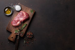 Raw ribeye beef steak cooking with ingredients Royalty Free Stock Photography