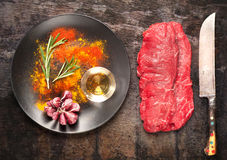Raw ribeye steak entrecote with herbs spices Stock Image