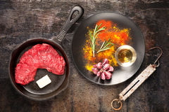 Raw ribeye steak entrecote with herbs spices Stock Photography