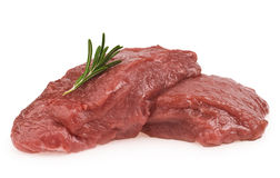 Raw ribeye steak. Garnished with a sprig of rosemary Royalty Free Stock Image