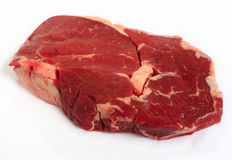 Raw ribeye steak on a white background Stock Images