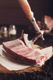 Raw ribs  on a  wooden table Royalty Free Stock Photos