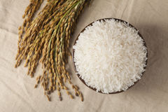 Raw rice. In a brown bowl Royalty Free Stock Photos
