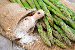 Raw rice and asparagus Stock Photography