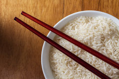Raw rice in bowl. Royalty Free Stock Images