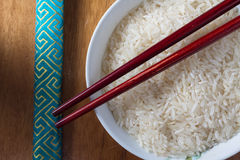 Raw rice in bowl Stock Images