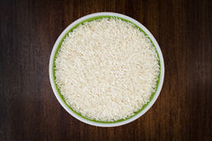 Raw rice in a bowl Stock Images