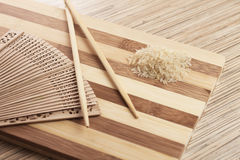 Raw rice on the breadboard Stock Photos