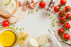 Raw rice and ingredients for cooking risotto. Royalty Free Stock Image