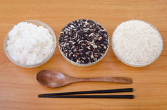 Raw rice, Selection Of black rice white rice and white steamed r Stock Image