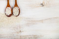 Raw rice in spoons Stock Photography