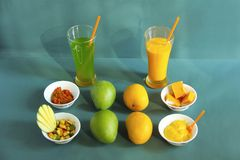 Raw and ripe alphonso mango and their by-products like pickle, mango shake, sweet and ice cream. Pune stock photo