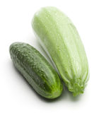 Raw ripe cucumber and squash. On a white background stock photography