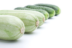 Raw ripe cucumbers and squashs. On a white background stock images
