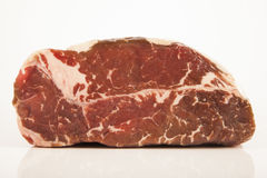 Raw roast beef meat. On white background Royalty Free Stock Images