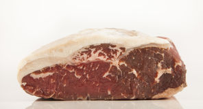 Raw roast beef meat. On white background Royalty Free Stock Image