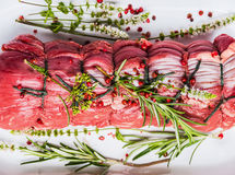 Raw roast beef  tied with a rope , herbs and spices, top view Royalty Free Stock Photography