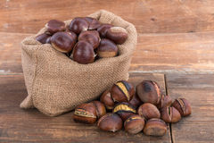Raw and roasted chestnuts Stock Photography