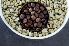Raw and roasted coffee beans Royalty Free Stock Image