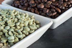 Raw and roasted coffee beans Royalty Free Stock Photo
