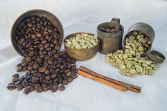 Raw and roasted coffee beans with brass cup Stock Photos