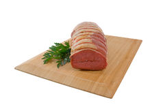 Raw Rolled Roast Beef over white background Stock Images