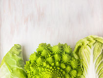 Raw Romanessco , Chinese and pointed cabbage on white wooden Stock Photos