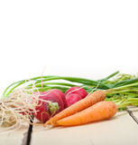 Raw root vegetable. On a rustic white wood table Stock Image