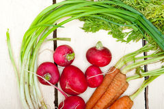 Raw root vegetable. On a rustic white wood table Stock Photos