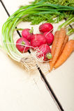 Raw root vegetable. On a rustic white wood table Royalty Free Stock Photos