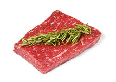 Raw rump steak. On white background with soft shadow and rosemary stick Stock Images