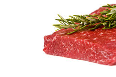 Raw rump steak. On white background with soft shadow and rosemary stick Stock Image