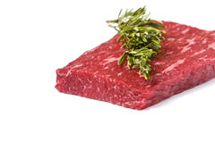 Raw rump steak. On white background with soft shadow and rosemary stick Royalty Free Stock Photography