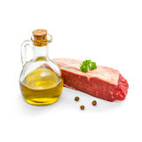 Raw rump steak with olive oil isolated Royalty Free Stock Images