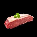Raw rump steak with parsley twig Royalty Free Stock Photo