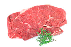 Raw Rump steak with sprig of Thyme Royalty Free Stock Photo