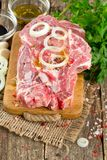 Raw rump steaks on wooden table Royalty Free Stock Photo