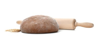 Raw rye dough, rolling pin and spikes. On white background Stock Photography