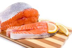 Raw salmon. On a wooden board isolated Stock Photography