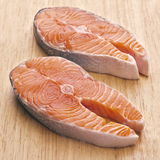 Raw salmon. Wheels on wooden board royalty free stock photo