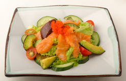 Raw salmon and avocado garden salad. Royalty Free Stock Images