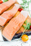 Raw salmon. Close up to raw salmon on wooden board,selective focus Stock Photography