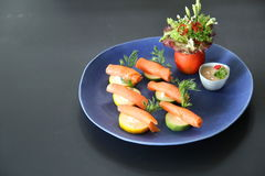 Raw salmon with cucumber Stock Photo
